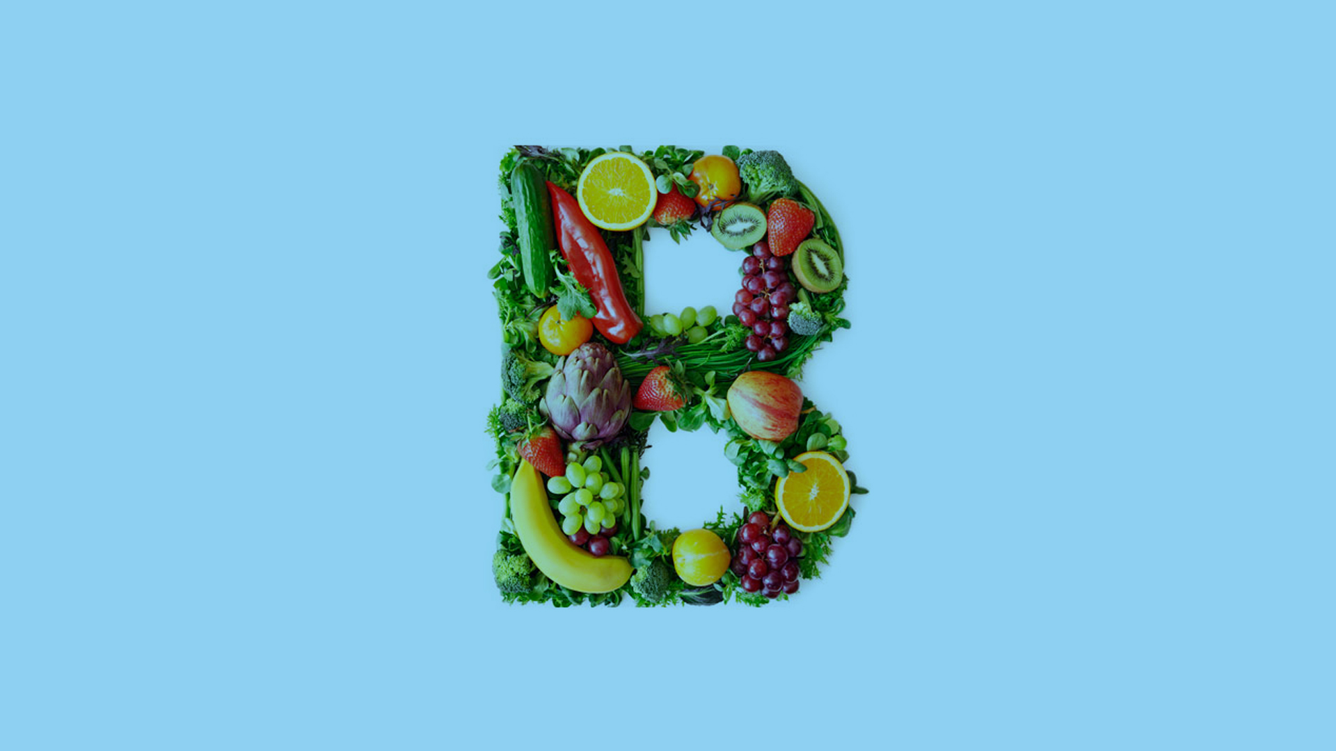 Imagem da letra B grande montada com diversas frutas e legumes