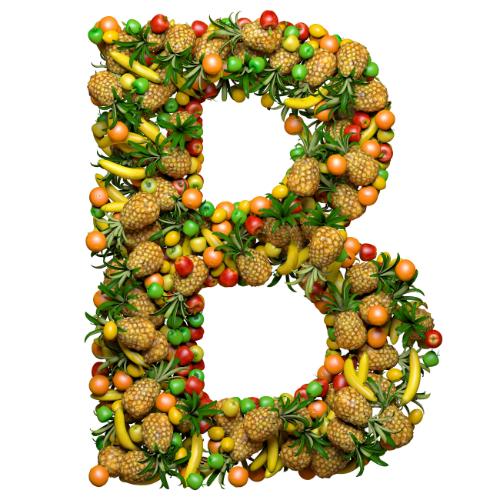 Imagem de um B grande cheio de frutas, como abacaxi, maça, laranja, limão e banana