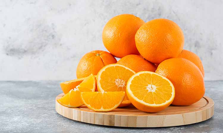 Imagem de diversas laranjas cortadas